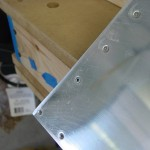Blind rivet in aft-most rib hole