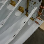 Nutplates installed on outboard seat ribs