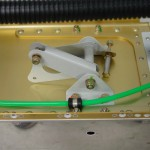 Pitot line secured under bellcrank